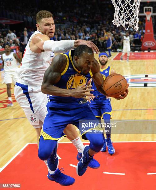 Andre Iguodala of the Golden State Warriors is fouled by Blake Griffin of the Los Angeles Clippers as he drives to the basket battle during the...