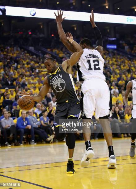 Andre Iguodala of the Golden State Warriors is fouled by LaMarcus Aldridge of the San Antonio Spurs during Game 2 of Round 1 of the 2018 NBA Playoffs...