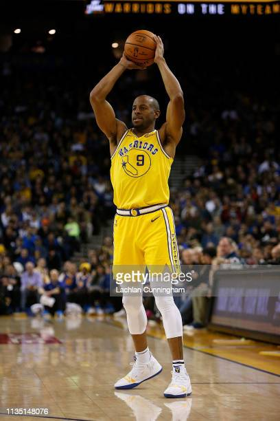 Andre Iguodala of the Golden State Warriors looks to pass the ball against the Phoenix Suns at ORACLE Arena on March 10 2019 in Oakland California...