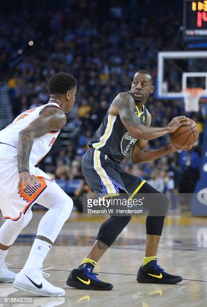 Andre Iguodala of the Golden State Warriors looks to pass the ball while guarded by Marquese Chriss of the Phoenix Suns during an NBA basketball game...