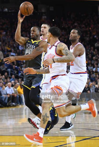 Andre Iguodala of the Golden State Warriors passes the ball on a fast break against the Phoenix Suns during an NBA basketball game at ORACLE Arena on...