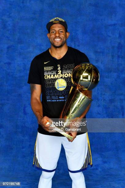 Andre Iguodala of the Golden State Warriors poses for a portrait with the Larry O'Brien Championship trophy after defeating the Cleveland Cavaliers...