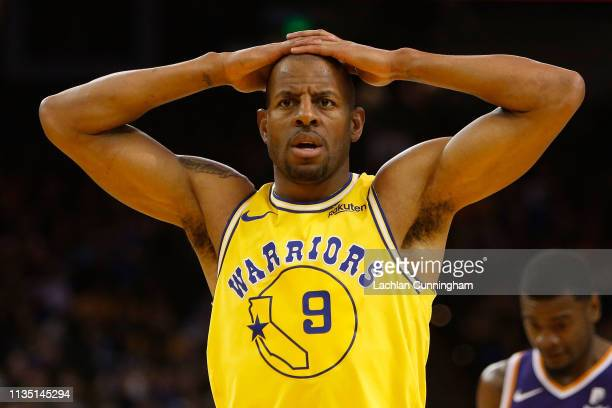 Andre Iguodala of the Golden State Warriors reacts to a play against the Phoenix Suns at ORACLE Arena on March 10 2019 in Oakland California NOTE TO...