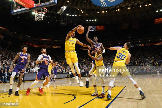 Andre Iguodala of the Golden State Warriors rebounds the ball against the Phoenix Suns on March 10 2019 at ORACLE Arena in Oakland California NOTE TO...