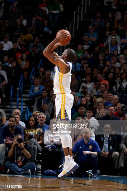 Andre Iguodala of the Golden State Warriors shoots a three point basket during the game against the Oklahoma City Thunder on March 16 2019 at...