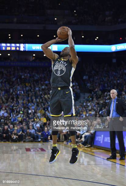 Andre Iguodala of the Golden State Warriors shoots a threepoint shot against the Dallas Mavericks during an NBA basketball game at ORACLE Arena on...