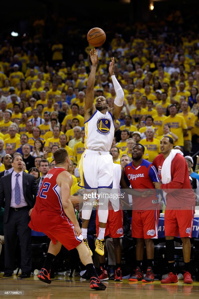 Andre Iguodala #9 of the Golden State Warriors shoots a three-pointer over Blake Griffin #32 of the Los Angeles Clippers in Game Six of the Western Conference Quarterfinals during the 2014 NBA Playoffs at ORACLE Arena on May 1, 2014 in Oakland, California. Iguodala made the basket and Griffin was called for his sixth foul on the play.