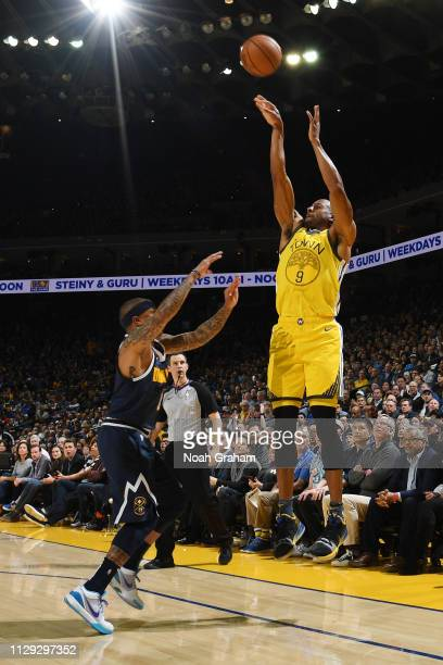 Andre Iguodala of the Golden State Warriors shoots the ball against the Denver Nuggets on March 8 2019 at ORACLE Arena in Oakland California NOTE TO...