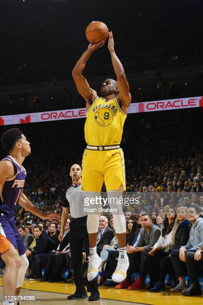 Andre Iguodala of the Golden State Warriors shoots the ball against the Phoenix Suns on March 10 2019 at ORACLE Arena in Oakland California NOTE TO...