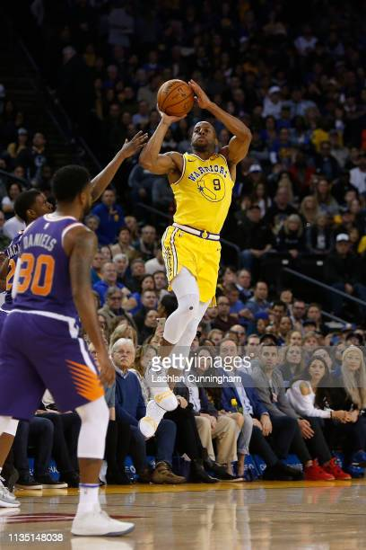 Andre Iguodala of the Golden State Warriors shoots the ball against the Phoenix Suns at ORACLE Arena on March 10 2019 in Oakland California NOTE TO...