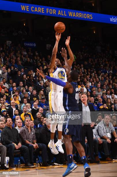 Andre Iguodala of the Golden State Warriors shoots the ball against the Dallas Mavericks on December 14 2017 at ORACLE Arena in Oakland California...