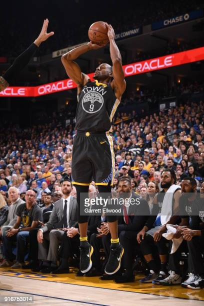 Andre Iguodala of the Golden State Warriors shoots the ball against the San Antonio Spurs on February 10 2018 at Oracle Arena in Oakland California...