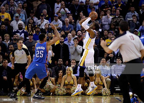 Andre Iguodala of the Golden State Warriors shoots the game winning shot at the buzzer over Thabo Sefolosha of the Oklahoma City Thunder to win the...
