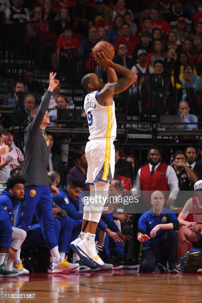 Andre Iguodala of the Golden State Warriors shoots three point basket against the Houston Rockets on March 13 2019 at the Toyota Center in Houston...