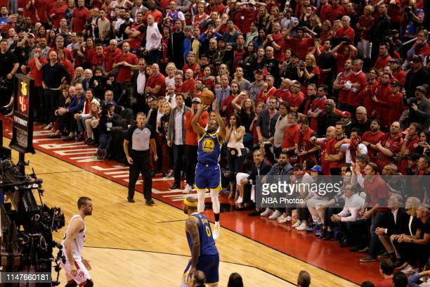 Andre Iguodala of the Golden State Warriors shoots three point basket to seal the game against the Toronto Raptors during Game Two of the NBA Finals...