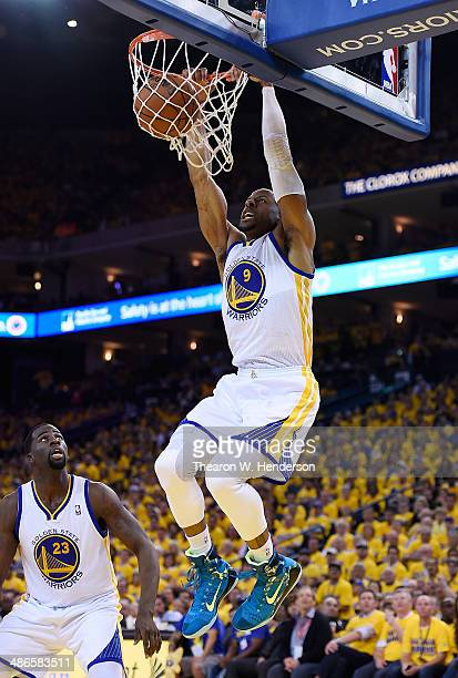 Andre Iguodala of the Golden State Warriors slam dunks the ball against the Los Angeles Clippers in Game Three of the Western Conference...