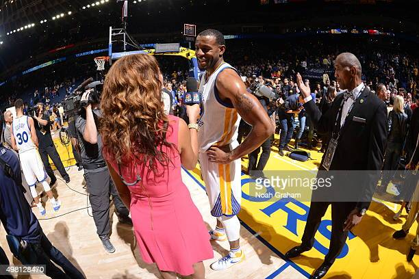 Andre Iguodala of the Golden State Warriors speaks with sideline reporter Rosalyn GoldOnwude after defeating the Chicago Bulls on November 20 2015 at...