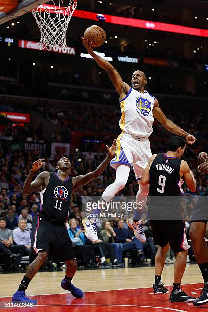 Andre Iguodala of the Golden State Warriors splits the defense of Jamal Crawford and Pablo Prigioni of the Los Angeles Clippers during the first half...