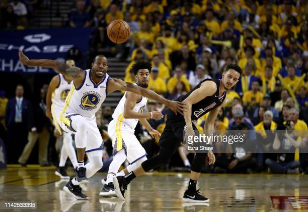Andre Iguodala of the Golden State Warriors steals the ball from Landry Shamet of the LA Clippers during Game One of the first round of the 2019 NBA...