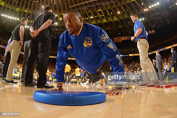 Andre Iguodala of the Golden State Warriors stretches before Game Five of the Western Conference Finals against the Oklahoma City Thunder during the...