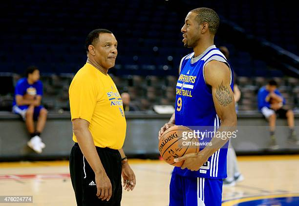 Andre Iguodala of the Golden State Warriors talks to assistant coach Alvin Gentry during practice for the 2015 NBA Finals against the Cleveland...