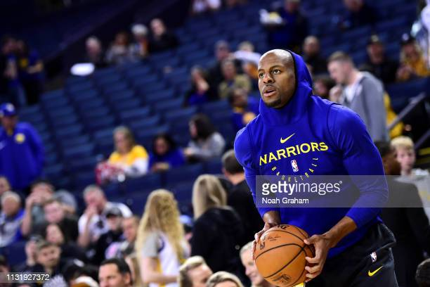 Andre Iguodala of the Golden State Warriors warms up before the game against the Indiana Pacers on March 21 2019 at ORACLE Arena in Oakland...