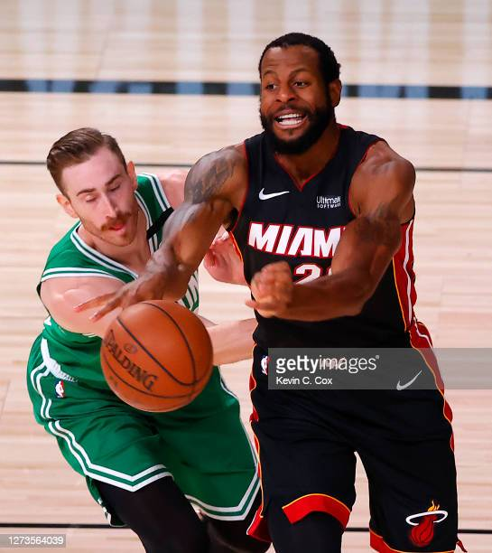 Andre Iguodala of the Miami Heat passes the ball against Gordon Hayward of the Boston Celtics during the second quarter in Game Three of the Eastern...