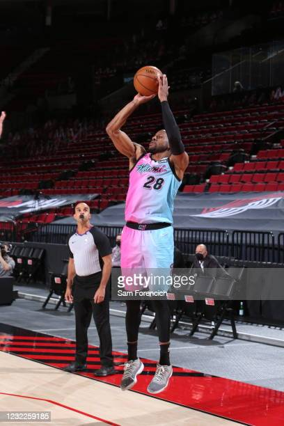 Andre Iguodala of the Miami Heat shoots the ball during the game against the Portland Trail Blazers on April 11, 2021 at the Moda Center Arena in...