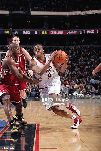 Andre Iguodala of the Philadelphia 76ers dribble drives to the basket against Eric Snow of the Cleveland Cavaliers during a game at Wachovia Center...