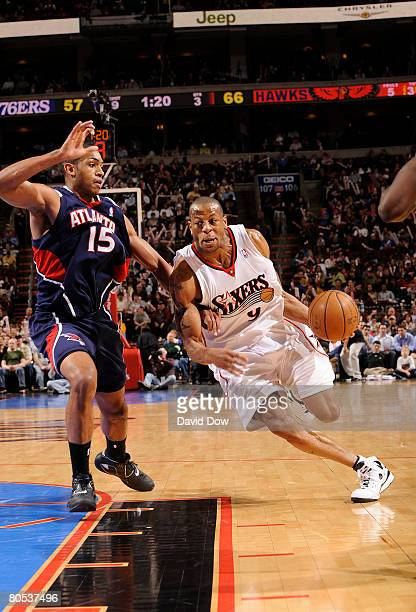 Andre Iguodala of the Philadelphia 76ers drives against Al Horford of the Atlanta Hawks at the Wachovia Center April 5 2008 in Philadelphia...