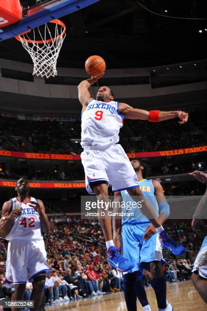 Andre Iguodala of the Philadelphia 76ers dunks against the Denver Nuggets during the game on January 30 2011 at the Wells Fargo Center in...