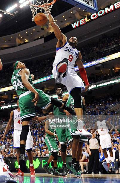 Andre Iguodala of the Philadelphia 76ers dunks over Paul Pierce of the Boston Celtics in Game Six of the Eastern Conference Semifinals in the 2012...