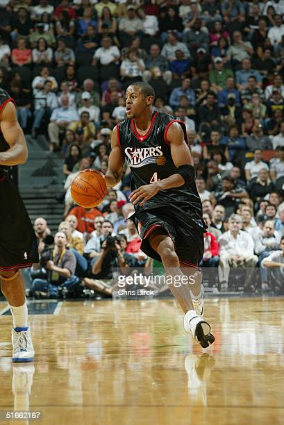 Andre Iguodala of the Philadelphia 76ers moves the ball during the preseason game with the San Antonio Spurs at SBC Center on October 21, 2004 in San...