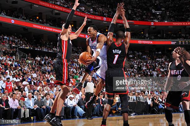Andre Iguodala of the Philadelphia 76ers passes against Zydrunas Ilgauskas and Chris Bosh of the Miami Heat in Game Three of the Eastern Conference...