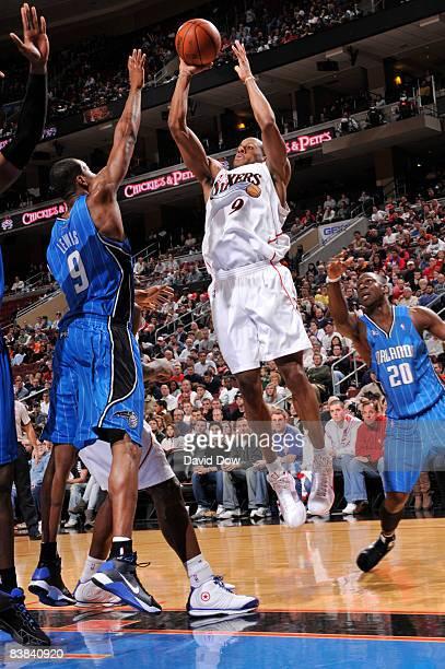 Andre Iguodala of the Philadelphia 76ers shoots against Rashard Lewis of  the Orlando Magic during the d99b52e83