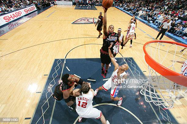 Andre Iguodala of the Philadelphia 76ers shoots against Richard Jefferson of the New Jersey Nets at the Continental Airlines Arena on December 10...