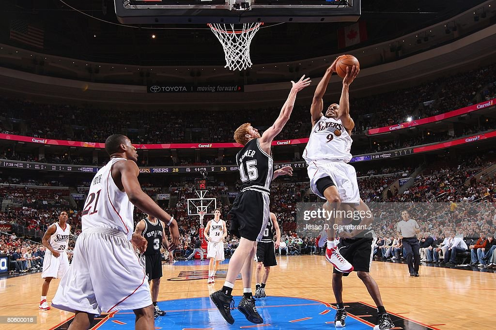 Andre Iguodala #9 of the Philadelphia 76ers takes the ball to the basket against Matt Bonner#15 of the San Antonio Spurs during the game on March 15, 2008 at the Wachovia Center in Philadelphia, Pennsylvania. The Sixers won 103-96.
