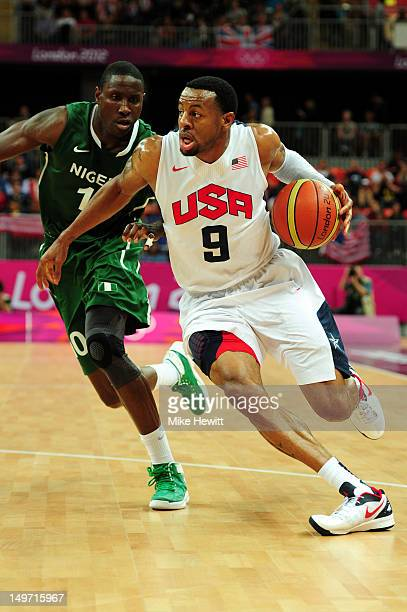Andre Iguodala of United States dribbles in front of Koko Archibong of Nigeria during the Men's Basketball Preliminary Round match against Nigeria on...