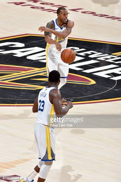 OH Andre Iguodala passes the ball to Draymond Green of the Golden State Warriors during the game against the Cleveland Cavaliers in Game Four of the...