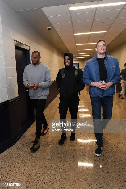 Andre Iguodala Quinn Cook and Jonas Jerebko of the Golden State Warriors arrive to the game against the Oklahoma City Thunder on March 16 2019 at...