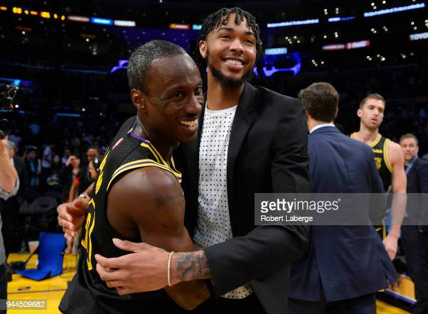 Andre Ingram and Brandon Ingram of the Los Angeles Lakers hug each other after the game against the Houston Rockets on April 10 2018 at STAPLES...