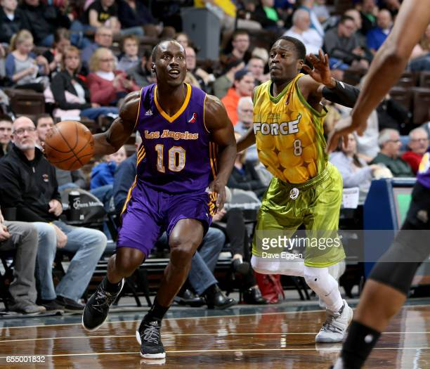 Andre Ingram from the Los Angeles DFenders drives to the basket in front of Bubu Palo from the Sioux Falls Skyforce at the Sanford Pentagon March 18...