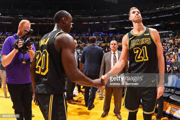 Andre Ingram of the Los Angeles Lakers and Tyler Zeller of the Los Angeles Lakers shake hands after the game against the Houston Rockets on April 10...