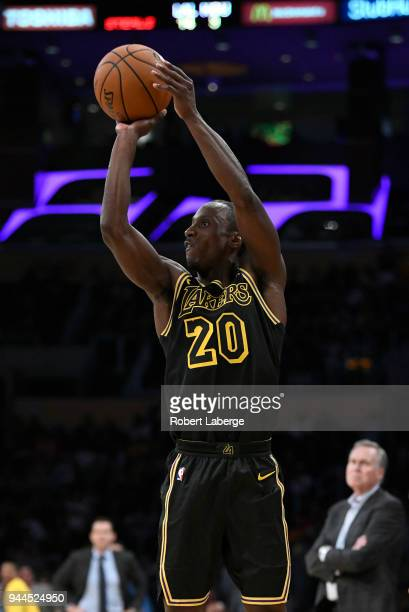 Andre Ingram of the Los Angeles Lakers attempts a jump shot as Mike D'Antoni head coach of the Houston Rockets looks on on April 10 2018 at STAPLES...