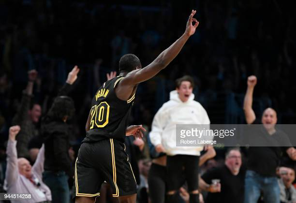 Andre Ingram of the Los Angeles Lakers celebrates after making a three pointer in the second half of the game against the Houston Rockets on April 10...