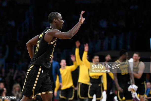 Andre Ingram of the Los Angeles Lakers celebrates after making a basket during the first half of the game against the Houston Rockets on April 10...