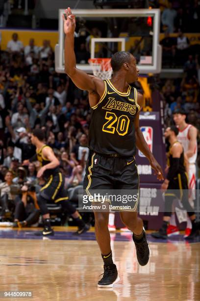 Andre Ingram of the Los Angeles Lakers celebrates hitting a three point shot during the game against the Houston Rockets on April 10 2017 at STAPLES...