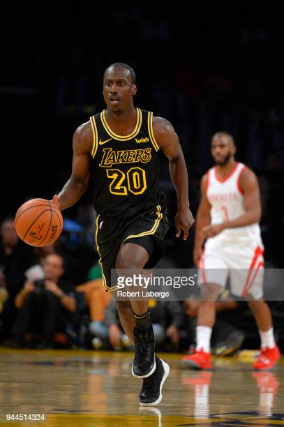 Andre Ingram of the Los Angeles Lakers dribbles the ball as Chris Paul of the Houston Rockets looks on on April 10 2018 at STAPLES Center in Los...