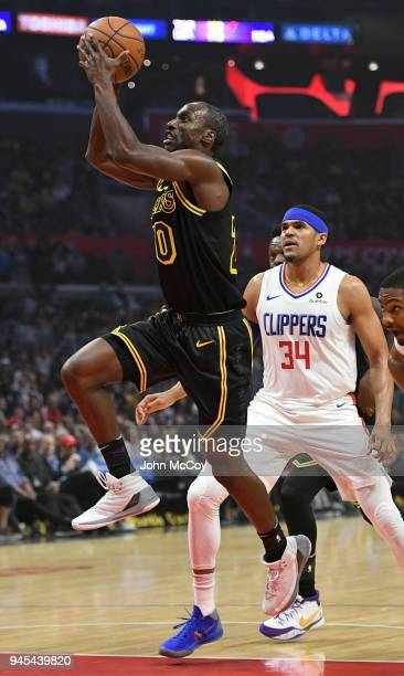 Andre Ingram of the Los Angeles Lakers gets past Tobias Harris of the LA Clippers in the first half at Staples Center on April 11 2018 in Los Angeles...