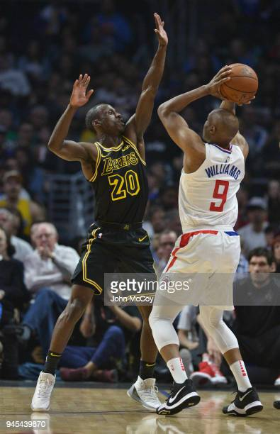 Andre Ingram of the Los Angeles Lakers guards CJ Williams of the LA Clippers in the first half at Staples Center on April 11 2018 in Los Angeles...